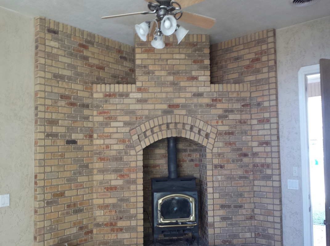 Fire place brick wall installation.